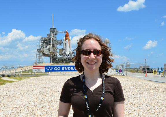 SPACE.com reporter Clara Moskowitz stands in front of the space shuttle Endeavour at Launch Pad 39A at Kennedy Space Center on the day before its final launch.