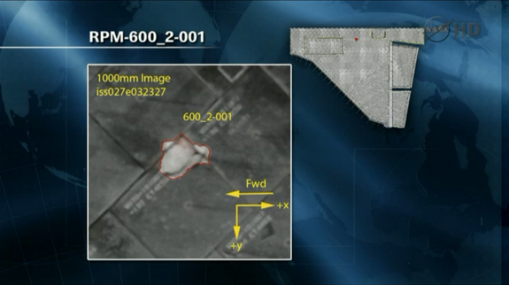 This NASA image shows the primary damaged tile on the space shuttle Endeavour that engineers are studying to determine whether any additional inspections or repairs are required while the shuttle is docked at the International Space Station during the STS-134 mission. This NASA image is from a May 19, 2011, briefing.