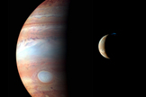 Jupiter and its volcanic moon Io, taken during the spacecraft's Jupiter flyby in early 2007.
