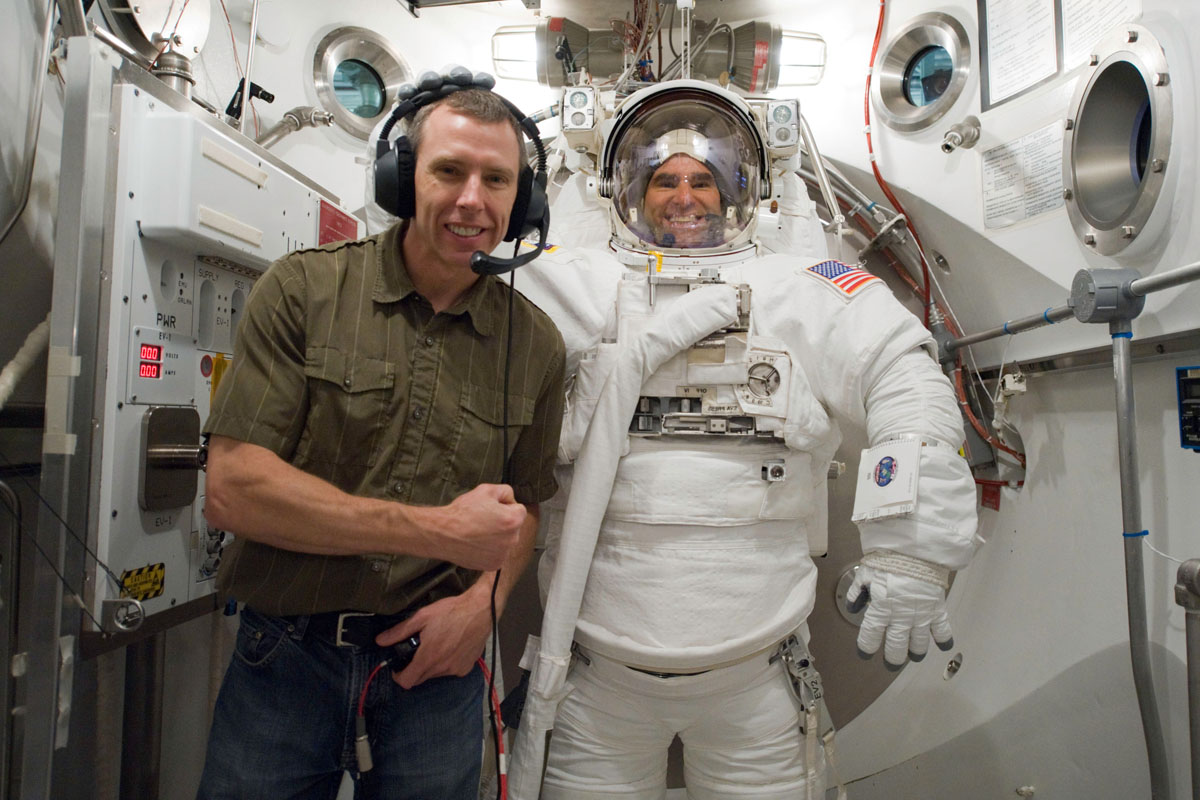 Shuttle Astronauts Perform Mission's First Spacewalk at Station