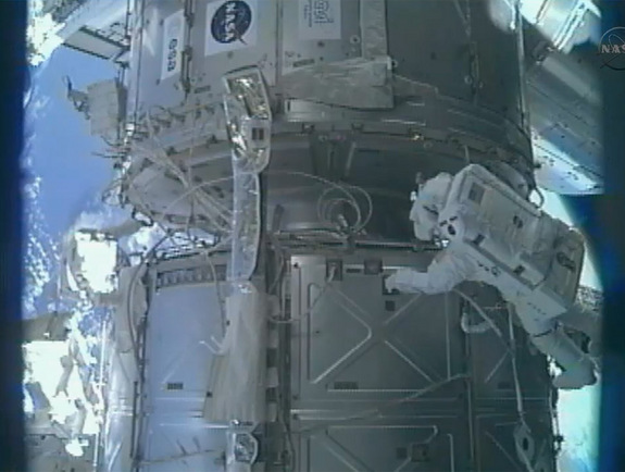Endeavour's STS-134 astronauts Drew Feustel and Greg Chamitoff conduct the first of four planned spacewalks on the outside of the Internaitonal Space Station.