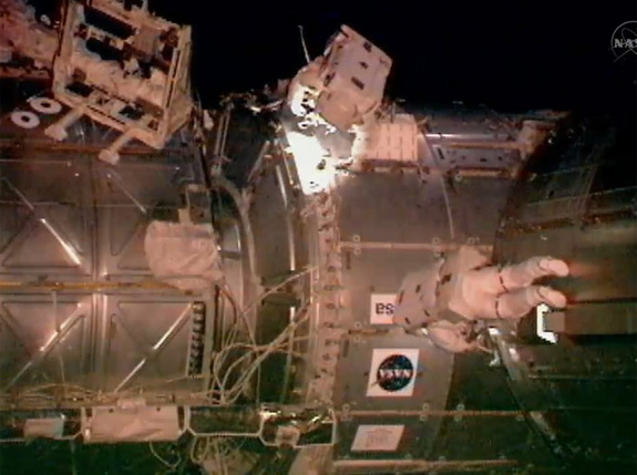 Astronauts Drew Feustel and Greg Chamitoff conduct a variety of tasks on the exterior of the International Space Station. The duo performed the first of four planned spacewalks during Endeavour's 16-day mission.
