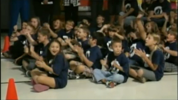This still from NASA TV shows some of the 400 schoolchildren at Mesa Verde Elementary School in Tucson, Ariz., as they cheer when speaking with Endeavour shuttle astronauts on May 22, 2011 during an event.
