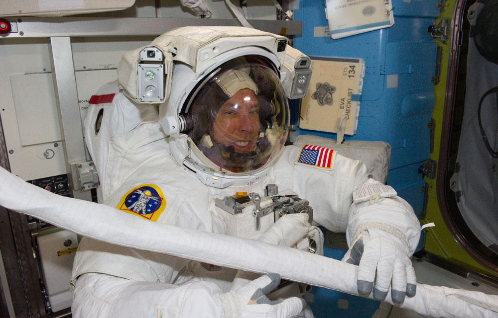 Wearing an Extravehicuar Mobility Unit Suit