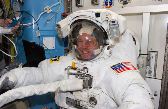 Wearing an Extravehicular Mobility Unit spacesuit, NASA astronauts Michael Fincke and Andrew Feustel (not visible), both STS-134 mission specialists, get prepared for the mission's second spacewalk onboard the International Space Station (ISS), on May 22, 2011 (Flight Day 7).