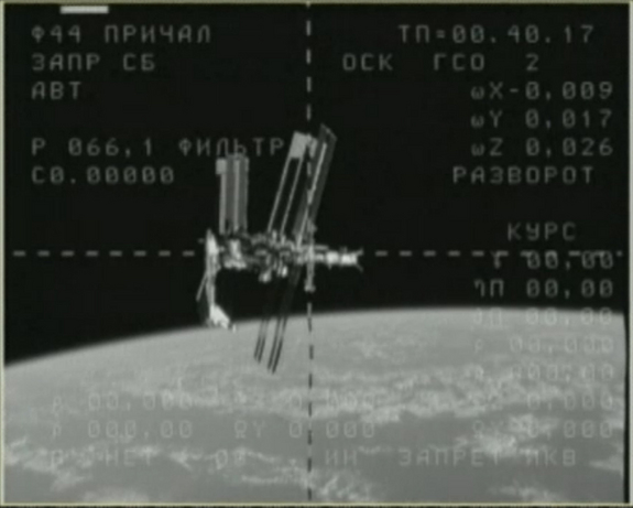 This still from NASA TV shows the space shuttle Endeavour (at left) while it is docked at the International Space Station on May 23, 2011 during the shuttle's final spaceflight before being retired. A video camera on a Russian Soyuz spacecraft caught this view just after undocking. An astronaut on the Soyuz snapped more photos and video of the unprecedented sight at the International Space Station.