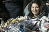 NASA astronaut Cady Coleman smiles and holds flowers presented to her after she and crewmates landed back on Earth on May 23, 2011. The Soyuz TMA-20 space capsule carrying Coleman and her two Expedition 27 crewmates landed in Kazakhstan to end their 157-day mission to the International Space Station.
