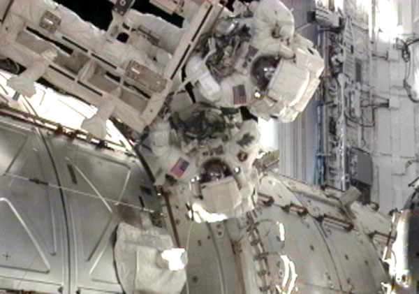 Spacewalking Astronauts Upgrade Space Station Despite Discomfort