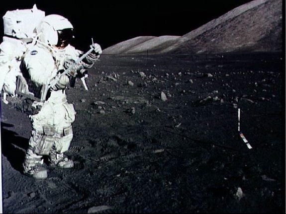 Astronaut Harrison Schmitt collects lunar rake samples during an Apollo 17 moonwalk in December 1972.