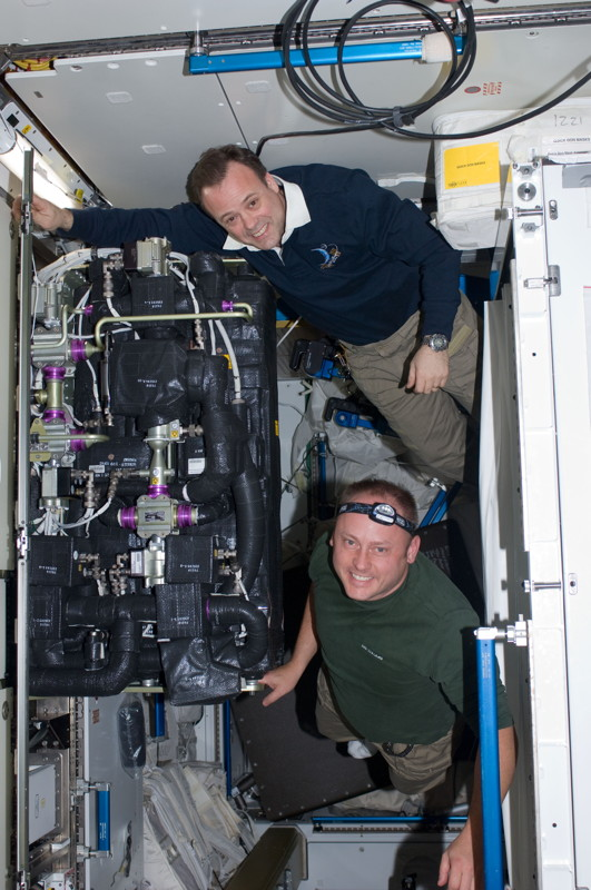Fincke and Garan Performing Maintenance Work Aboard the ISS
