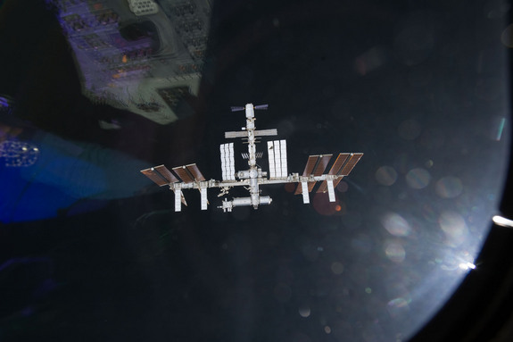 This view of the International Space Station was taken as it appeared on May 18, 2011 to the crew of space shuttle Endeavour just before the shuttle docked at the orbiting laboratory.