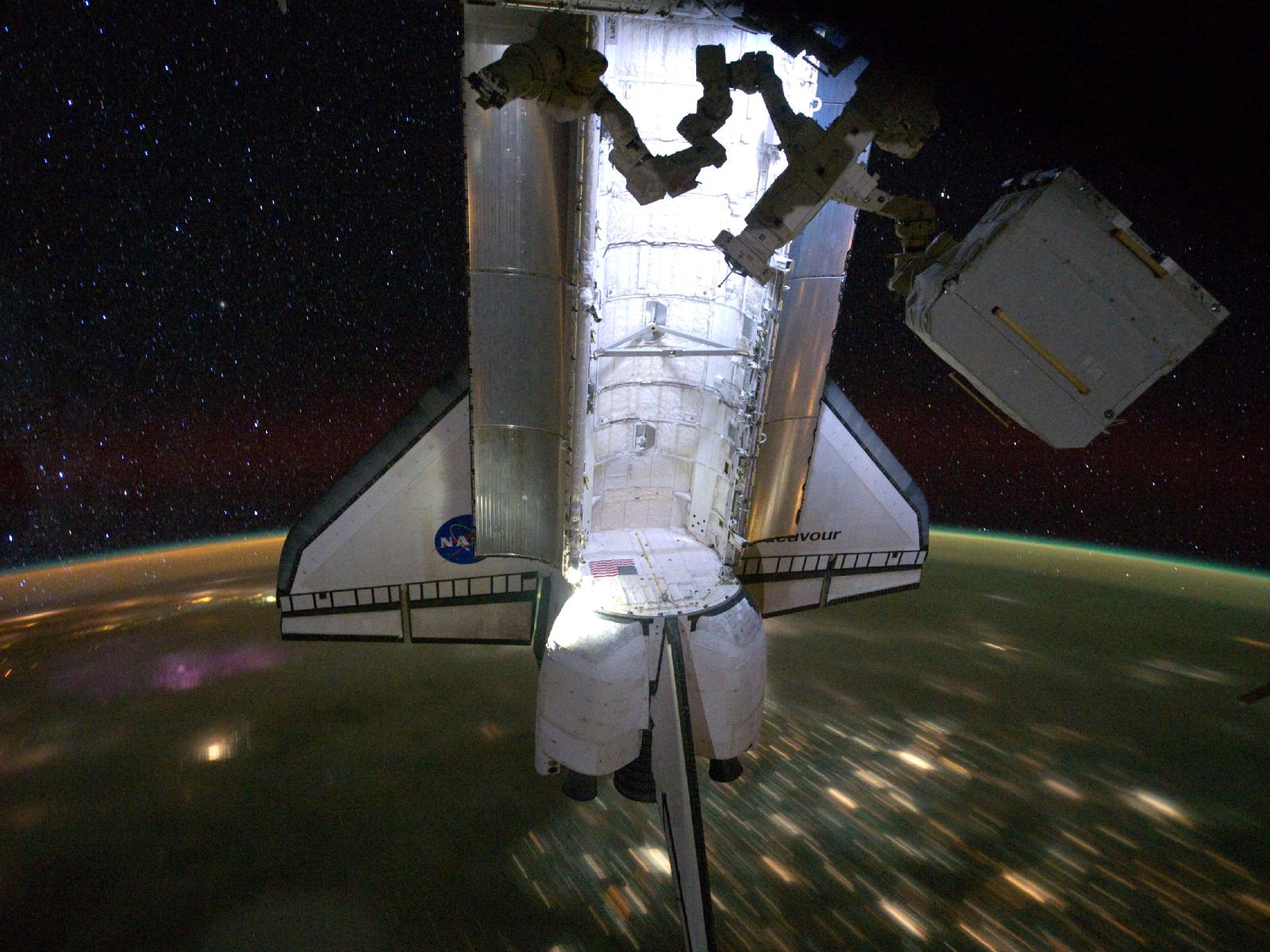 Shuttle Endeavour Over Earth at Night