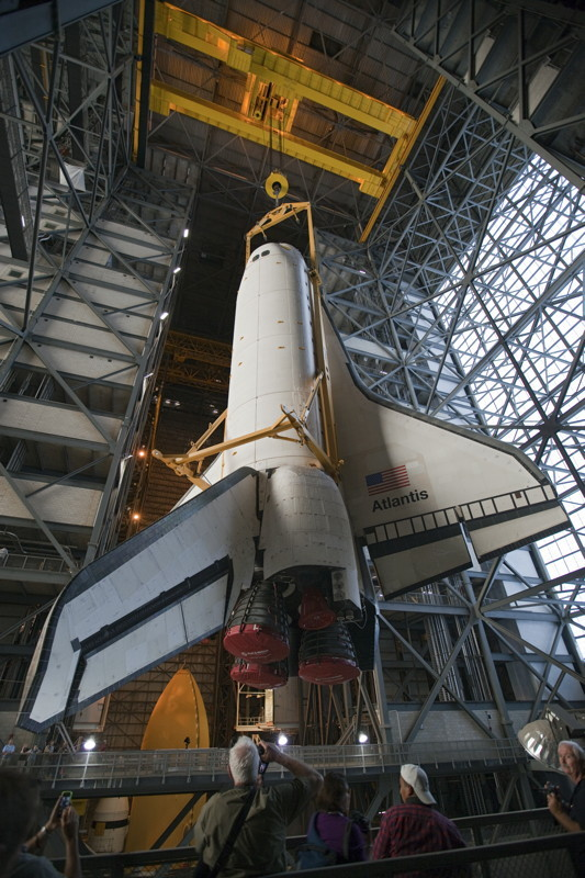 In the Vehicle Assembly Building at NASA's Kennedy Space Center in Florida, shuttle Atlantis is lifted by an overhead crane and moved into a high bay where it will be attached to its external fuel tank and solid rocket boosters which are already on the mobile launcher platform. NASA plans to launch Atlantis on the STS-135 mission in mid-July 2011.