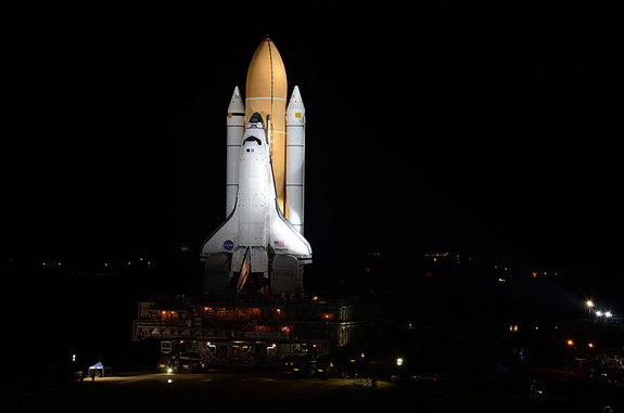 The space shuttle Atlantis rolls out to Launch Pad 39A in preparation for its final launch in July.