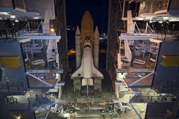 Space shuttle Atlantis, attached to its external fuel tank and solid rocket boosters atop a mobile launcher platform, slowly inches out of the Vehicle Assembly Building for the final time, on May 31, 2011.