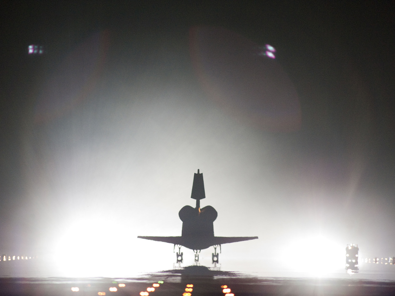Xenon lights help lead space shuttle Endeavour home to NASA's Kennedy Space Center in Florida.