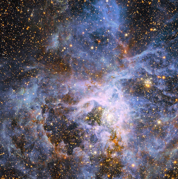 This view shows part of the very active star-forming region around the Tarantula Nebula in the Large Magellanic Cloud, a small neighbor of the Milky Way. At the exact center lies the brilliant but isolated star VFTS 682 and to its lower right the very rich star cluster R 136.