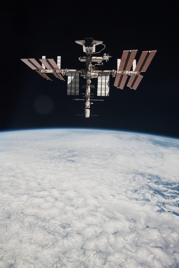 The space shuttle Endeavour is shown docked at the International Space Station in this first-ever view of the two spacecraft together as seen by astronauts on a nearby Russian Soyuz spacecraft. Expedition 27 crew member Paolo Nespoli from the Soyuz TMA-20 following its undocking on May 23, 2011 during the final flight of shuttle Endeavour, STS-134.