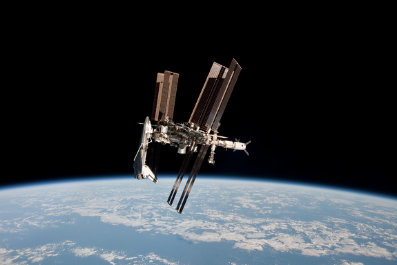 The space shuttle Endeavour and International Space Station shine front and center in this amazing (and historic) photo of the two vehicles docked together as seen from a Russian Soyuz spacecraft. Astronaut Paolo Nespoli snapped this view and others during the first-ever photo session of a shuttle docked at the space station.