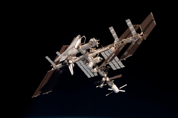 This photo of shuttle Endeavour at the International Space Station shows a rare look at the orbiter's underbelly while it is attached to the orbiting lab. This photo is one of the first-ever views of a NASA shuttle docked at the space station and was taken during Endeavour's final flight on May 23, 2011 by astronaut Paolo Nespoli on a nearby Soyuz spacecraft.