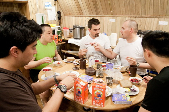 Members of the Mars500 crew share a meal together.