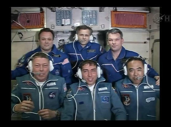 Front row (from left to right): NASA astronaut Mike Fossum, Russian cosmonaut Sergei Volkov and Japanese astronaut Satoshi Furukawa. Back row (left to right): NASA astronaut Ron Garan and Russian cosmonauts Andrey Borisenko and Alexander Samokutyaev. The space station's Expedition 28 crew receive well-wishes from Russian Mission Control in Moscow after Fossum, Volkov and Furukawa successfully docked to the station in their Soyuz spacecraft on June 9, 2011.