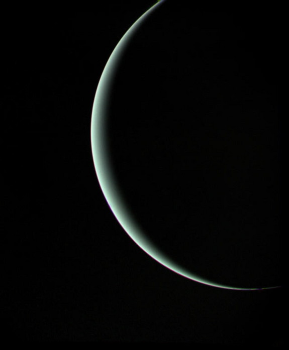 Voyager 2 departs a crescent Uranus on January 25, 1986, here seen from a range of 600,000 miles.
