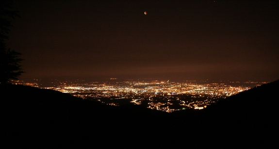 The city of Zagreb, Croatia shines under an eerie red moon during the total lunar eclipse of June 15, 2011. This photo was taken from Sljeme mountain in Croatia by a skywatcher Phillip Bailey.