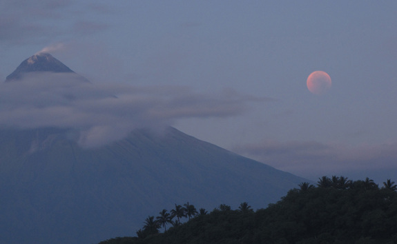 The total lunar eclipse of June 15, 2011 turns the moon a blood-red hue as steam rises from the Mayon volcano on Cagraray Island, Albay in the Philippines. Skywatcher David Matthews snapped this photo just before moonset during the eclipse.