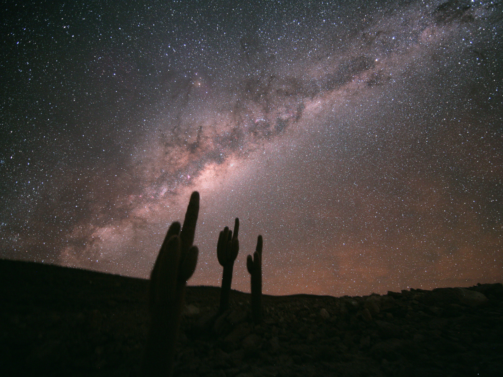 The Milky Way is seen in all its glory, as well as, in the lower right, the Large Magellanic Cloud.