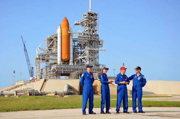 NASA's final space shuttle crew took part in a press conference on June 22, 2011 while standing behind their spacecraft, Atlantis, and Kennedy Space Center's Launch Pad 39A. From left to right: STS-135 mission specialists Rex Walheim, Sandra Magnus, pilot Doug Hurley and commander Chris Ferguson.