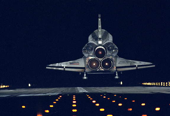 The space shuttle Endeavour glides back to Earth on Jan. 20, 1996, after nine days in space on the STS-72 mission. The orbiter is about to touch down on Runway 15 at the Shuttle Landing Facility at NASA's Kennedy Space Center in Cape Canaveral, Fla.
