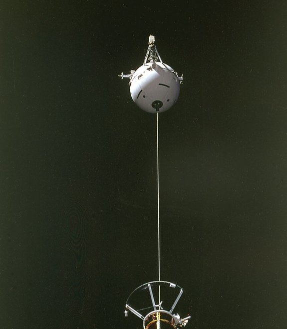 The Tethered Satellite System (TSS) being deployed from the space shuttle Atlantis during STS-46 in 1992. The photo was taken from onboard the shuttle.