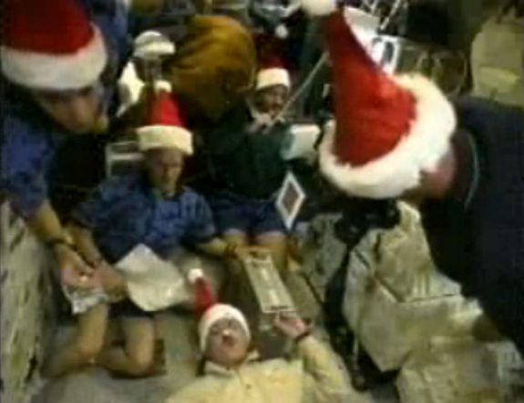 This still from a NASA video shows the only Christmas holiday mission by a space shuttle crew. The astronauts of NASA's STS-103 mission in December 1999 visited the Hubble Space Telescope for a repair flight and donned Santa hats to mark the Christmas holiday in space.