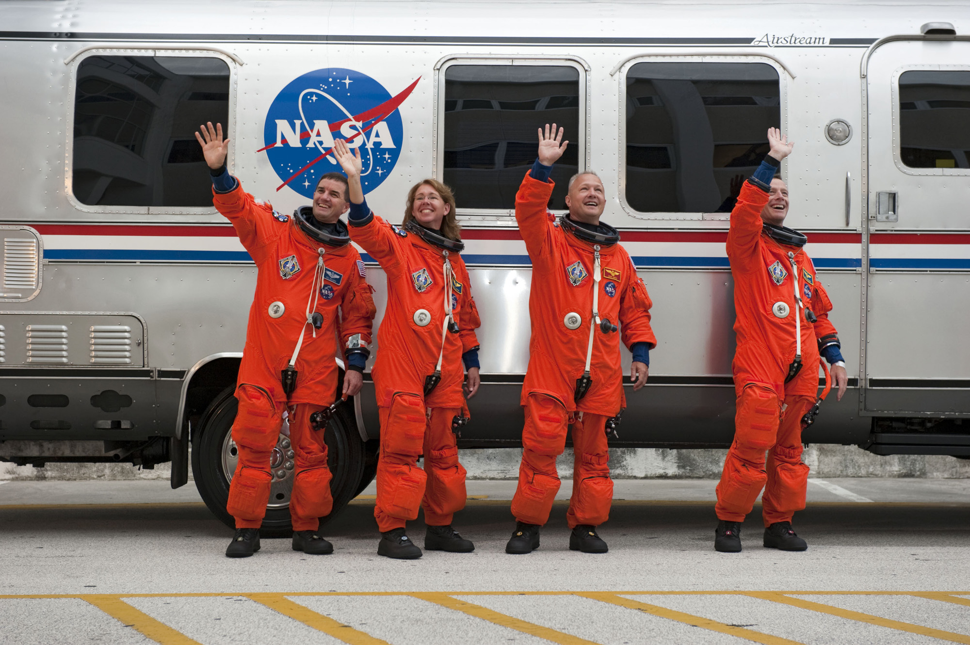 Last Shuttle Crew Waves Farewell