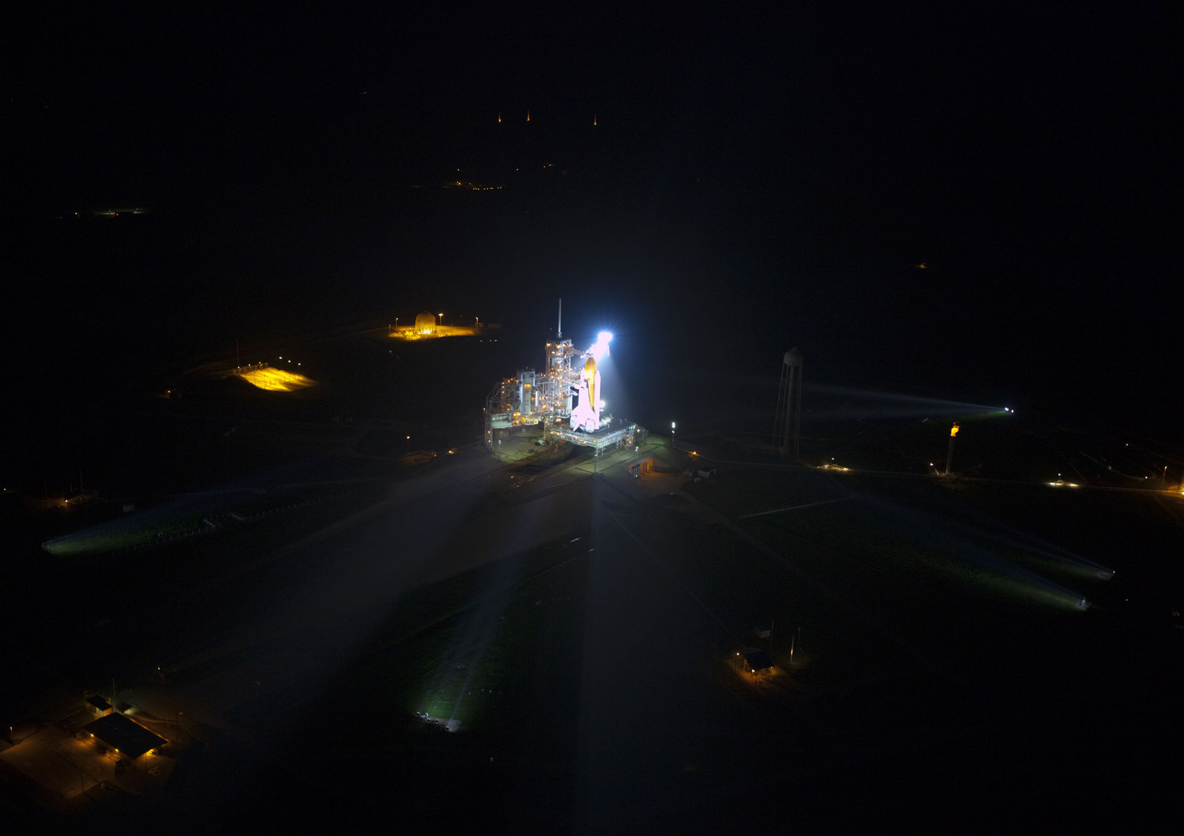 Space shuttle Atlantis lit up on launch pad