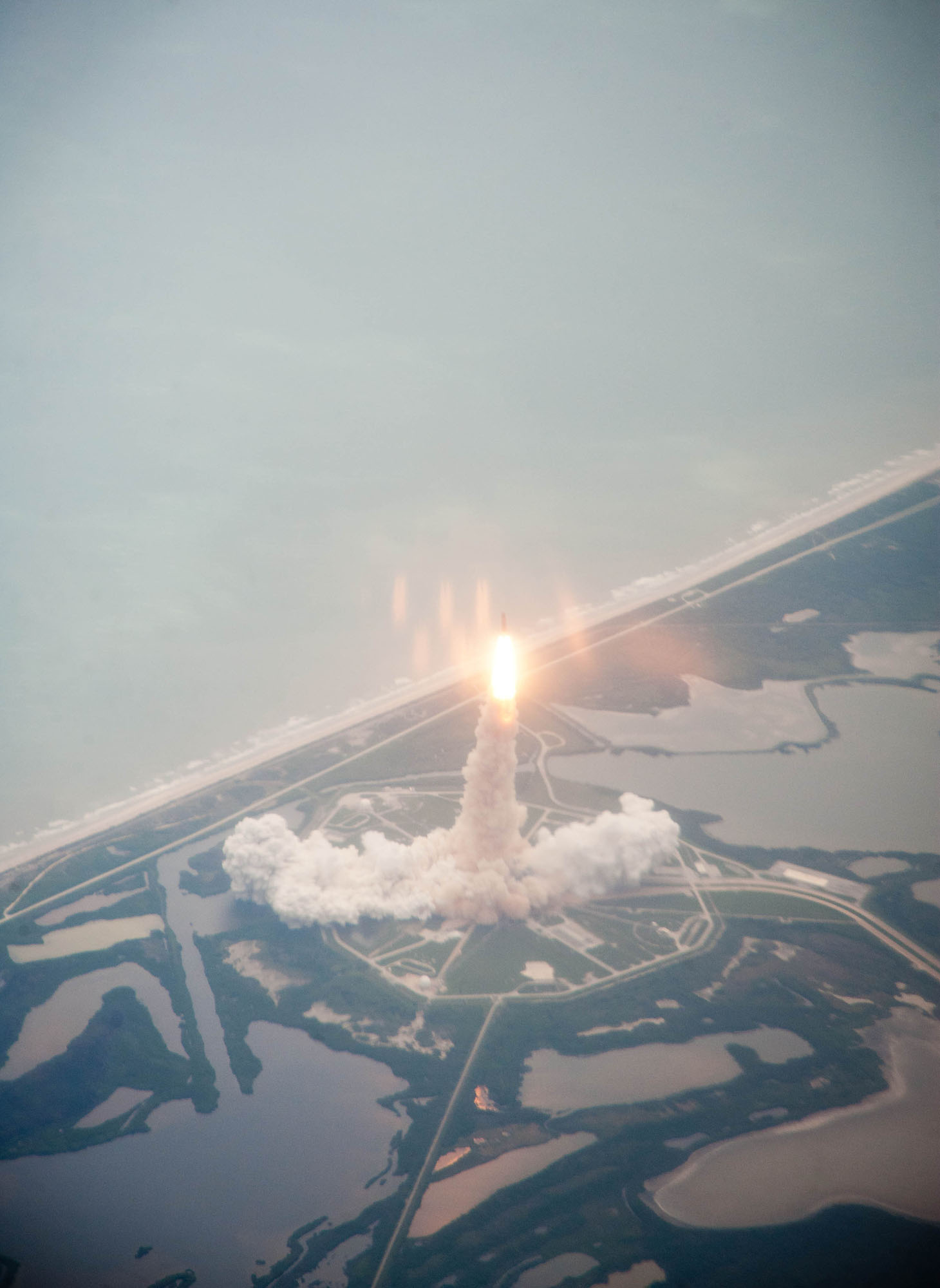 Shuttle Atlantis Liftoff Seen From Air