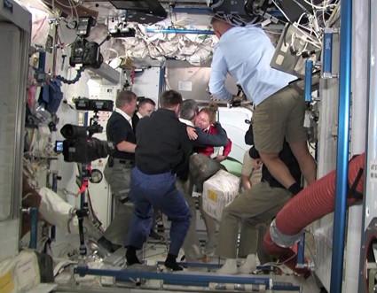 Atlantis' Crew Hugs ISS Crew