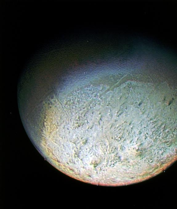 This color photo of Neptune's largest moon Triton was obtained by NASA's Voyager 2 probe on Aug. 24, 1989, from 330,000 miles away. The resolution is about 6.2 miles, sufficient to begin to show topographic detail.