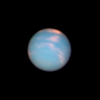 "On June 25, 2011, Neptune arrived at the same location in space where it was discovered 165 years earlier. To commemorate the event, NASA's Hubble Space Telescope took ""anniversary pictures"" of the blue-green giant planet."