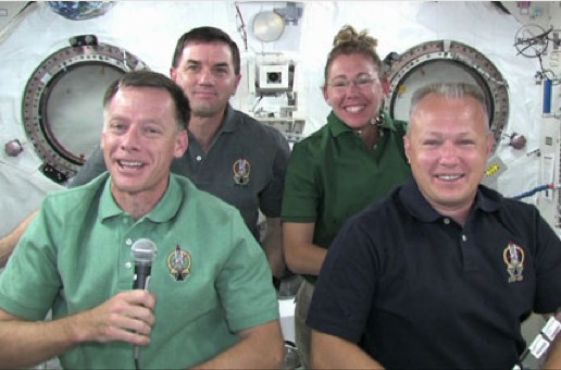 The STS-135 crew gathers in the Kibo module of the International Space Station to talk to reporters Wednesday. From left to right are Commander Chris Ferguson, Mission Specialists Rex Walheim and Sandy Magnus and Pilot Doug Hurley.