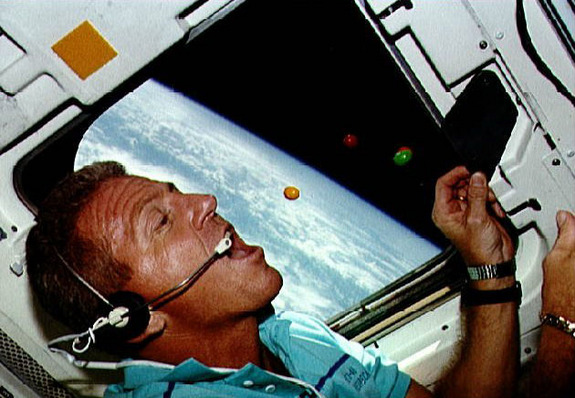 NASA astronaut Loren Shriver eats M&M's candy in weightlessness aboard the space shuttle Atlantis during the STS-42 mission in 1992.