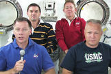 The STS-135 shuttle crew gathers in the Kibo module of the International Space Station to talk to reporters Thursday, July 14, 2011 during NASA's final shuttle flight. From left to right are Commander Chris Ferguson, Mission Specialists Rex Walheim and Sandy Magnus and Pilot Doug Hurley.