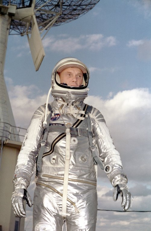 Astronaut John H. Glenn Jr. in his silver Mercury spacesuit during pre-flight training activities at Cape Canaveral. On February 20, 1962 Glenn lifted off into space aboard his Mercury Atlas (MA-6) rocket and became the first American to orbit the Earth. After orbiting the Earth 3 times, Friendship 7 landed in the Atlantic Ocean 4 hours, 55 minutes and 23 seconds later, just East of Grand Turk Island in the Bahamas. Glenn and his capsule were recovered by the Navy Destroyer Noa, 21 minutes after splashdown.