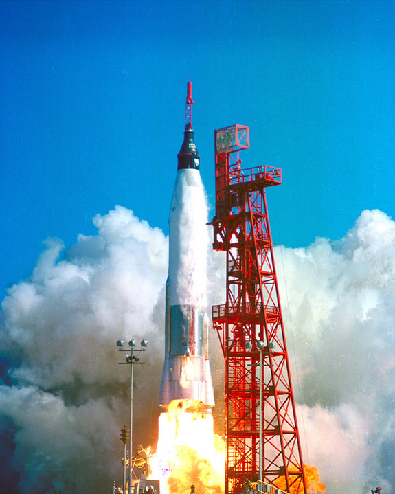 This image shows the launch of Friendship 7, the first American manned orbital space flight. With astronaut John Glenn aboard, the Mercury-Atlas rocket is launched from Pad 14, February 20, 1962.