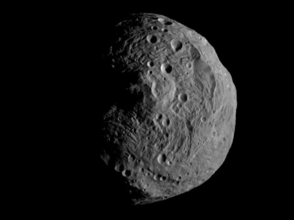 NASA's Dawn spacecraft obtained this image with its framing camera on July 17, 2011. It was taken from a distance of about 9,500 miles (15,000 kilometers) away from the protoplanet Vesta. Each pixel in the image corresponds to roughly 0.88 miles (1.4 kilometers)
