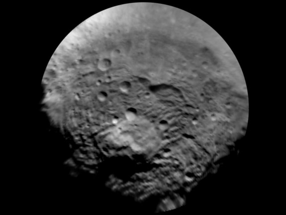 NASA's Dawn spacecraft took this image of the south polar region of Vesta, which has a diameter of 330 miles (530 kilometers). The image was taken on July 9, 2011, and it has a scale of about 2.2 miles (3.5 km) per pixel. To enhance details, the resolution was enlarged to .6 miles (1 km) per pixel. This region is characterized by rough topography, a large mountain, impact craters, grooves and steep scarps.
