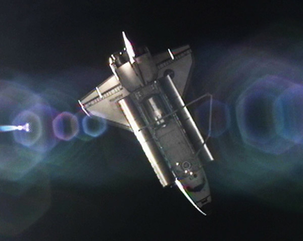 Shuttle Atlantis Undocks from Space Station for Last Time