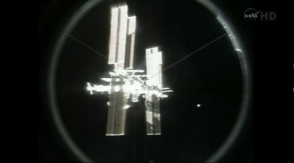This never-before-seen view of the International Space Station shows the orbiting lab as it appeared to astronauts on the shuttle Atlantis after the two spacecraft undocked for the final time on July 19, 2011 during NASA's final shuttle mission. The station rotated 90 degrees after undocking in an unprecedented manuever to provide better views to the shuttle crew.