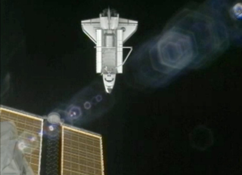 Atlantis After Undocking with ISS Solar Arrays in Foreground